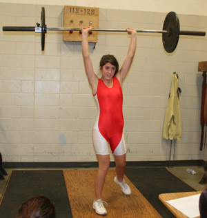 """PRESSURE.  At the first meet sophomore Gene Trujillo performed the clean and jerk. """"My goal for this season is to become stronger and lift more than my brother,"""" Trujillo said. This is Trujillo's first year on the team."""