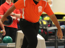 STRIKE. Sophomore Alex Siew bowls a strike for his first frame against Edgewater. The boys beat Edgewater. photo/Taylor Roberts