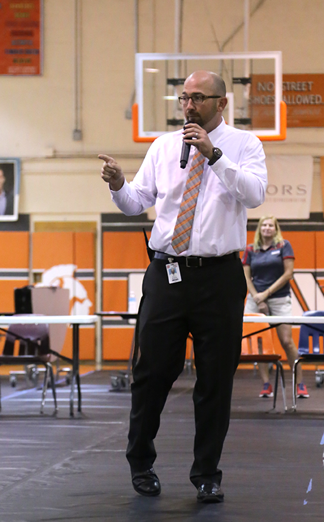 LISTEN UP. Principal Dusty Johns speaks to all of the student leaders about the rivalry.