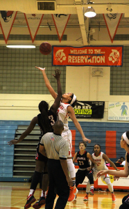 JUMP. Brittney Smith leaps for the ball during tip-off. (photo/Albany Alexander)