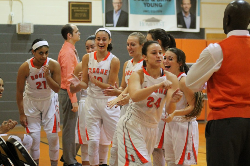 Get your head in the game. The lady braves get pumped up for a game by high fiving each other.