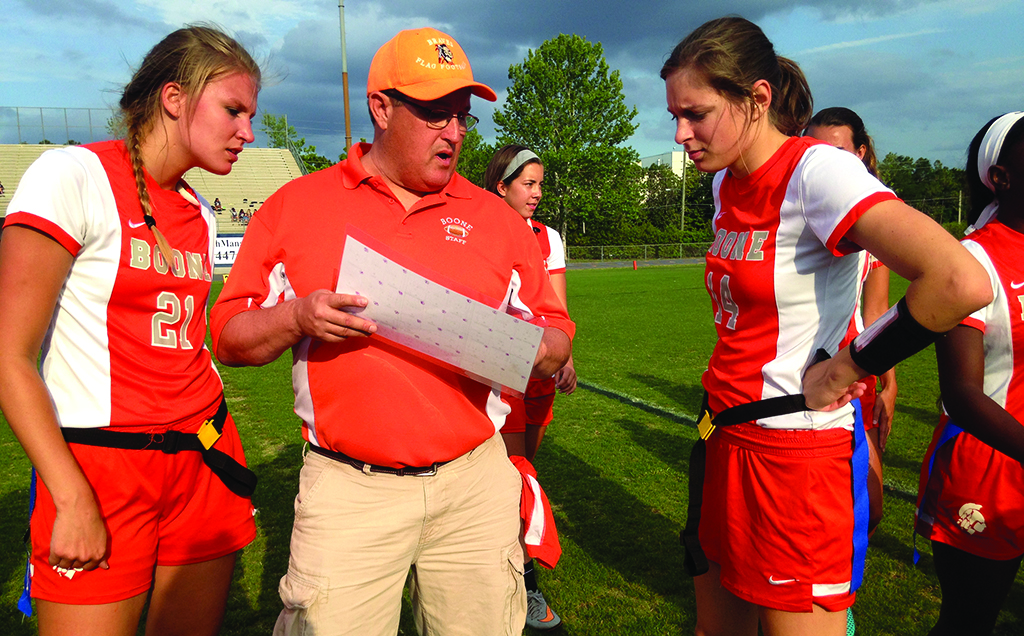 CLARITY. At halftime, coach Hensley clarifies plays to Senior Amanda Oliver and Senior Emily Colvin.