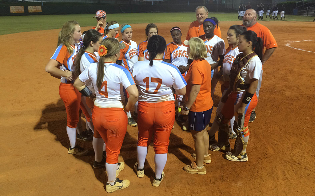 HUDDLE UP. After the game, coach Bradford huddles up with the team to discuss the big win