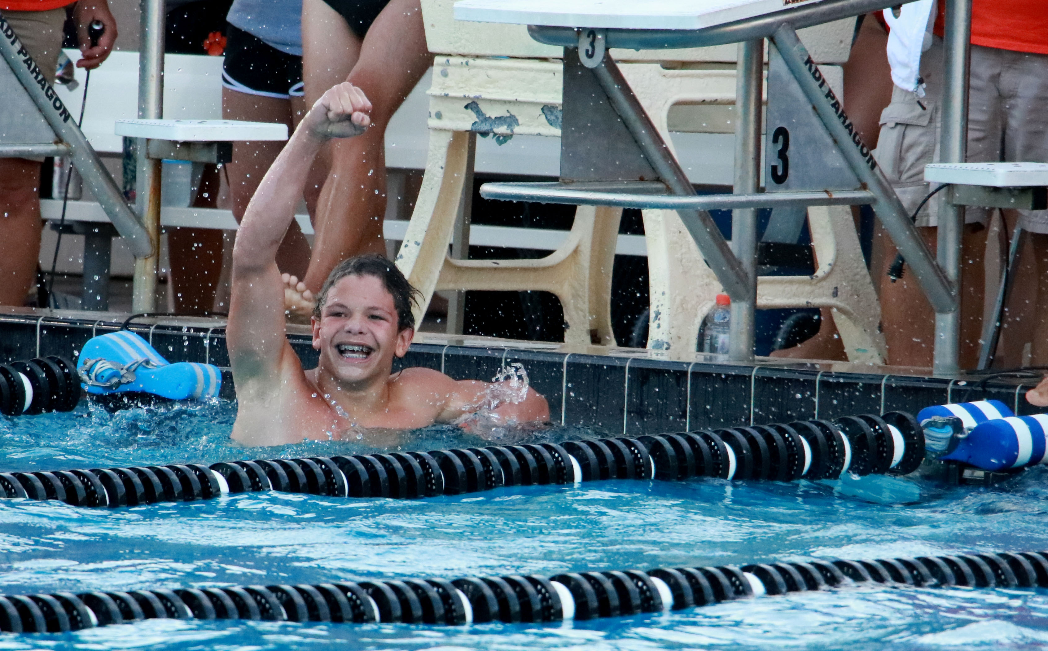 WINNER WINNER. Freshman Trey Bonham celebrates after winning his heat of the 100 freestyle.