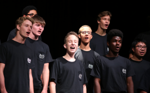 SING OFF. Freshman Robert Cohenstrom performs at the chorus concert. photo/ Sloan Warranch