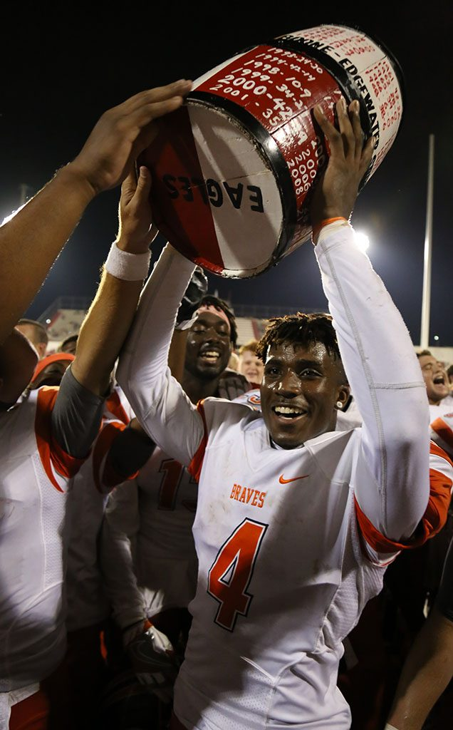 LIFT IT HIGH. Senior Tyree Jones hoists the barrel in front of the crowd, after a dominating victory over Edgewater.