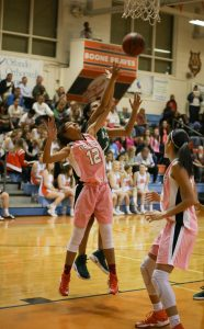 IT'S MINE.  Hands up, junior Amiya Bowers reaches for the rebound. photo/Albany Alexander