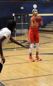 FOLLOW THROUGH. Junior Brittney Smith prepares to take a free throw. photo/Madeline Bogan