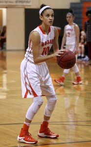 game face on. Junior Cassady Quintana shoots for a free throw. photo/ Madeline Bogan