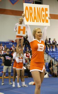 LOUD AND PROUD. Senior Jordan Wilson excites the audience by shouting the school colors. photo/Shayna Eaton