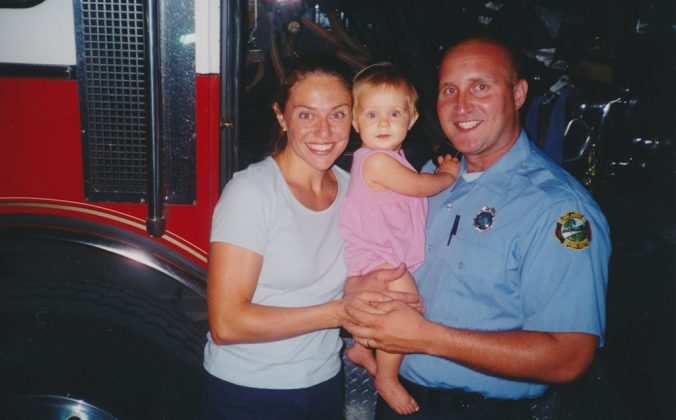 With her parents at the fire station