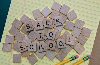 Back to school graphic through wooden chips